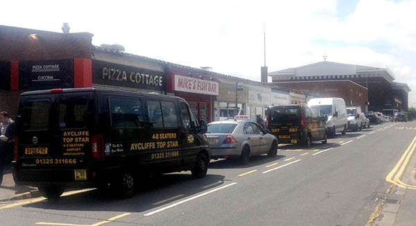 Taxis Park at Bus Stop Causes Congestion