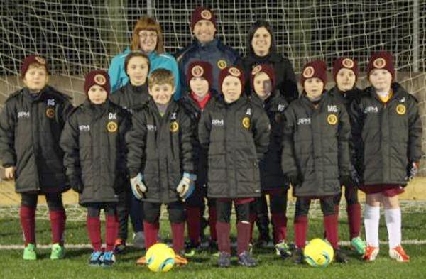 New Sponsor Keeps Under 9's Team Warm