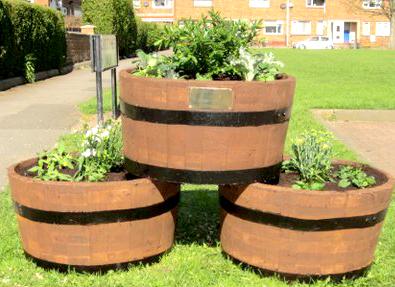 Residents Win Grant for Garden Tubs on Green