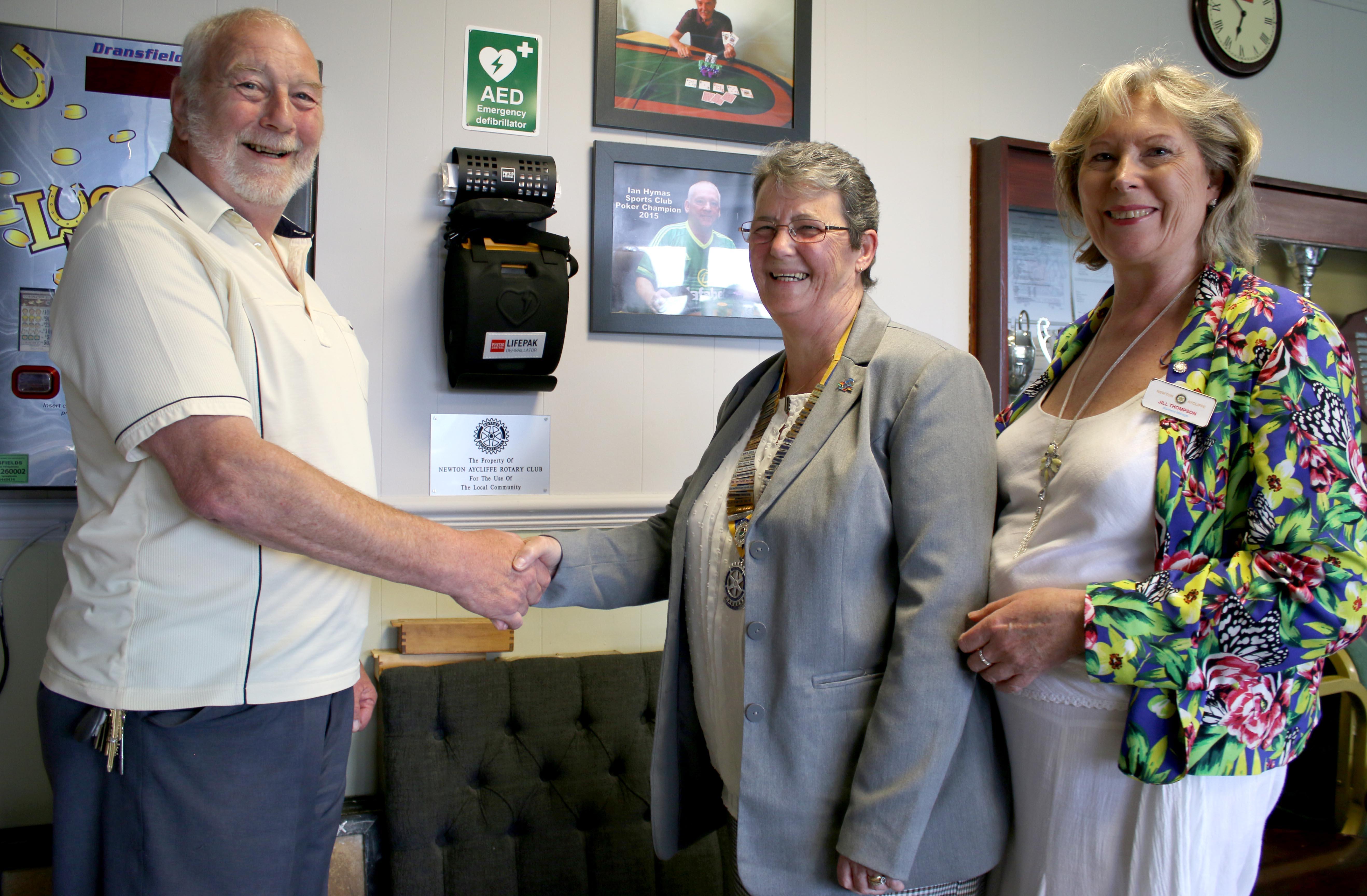 Rotary Club Defibrillator Transferred to Moore Lane Sports Club