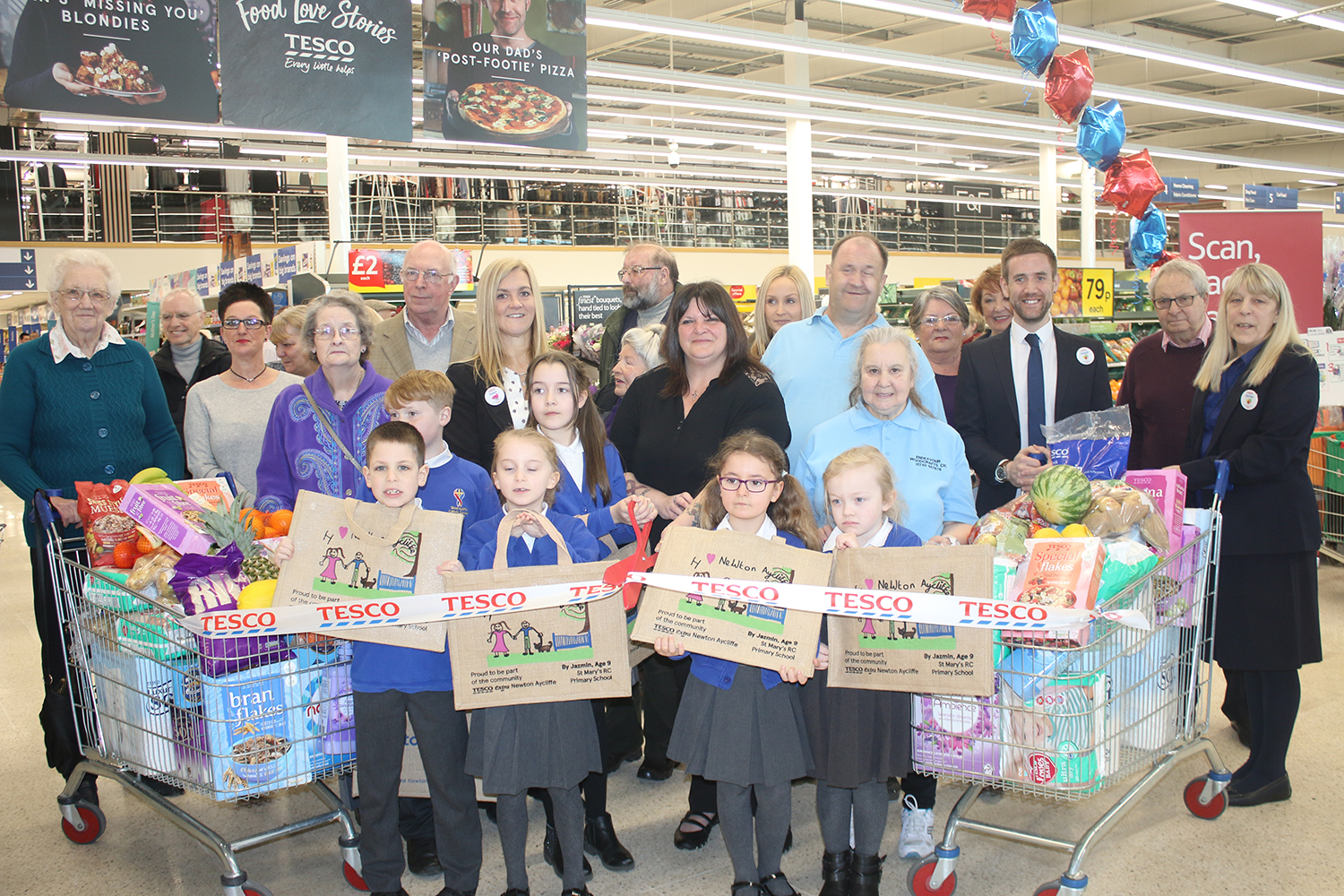 Shoppers Help Tesco Celebrate New Additions To Their Store