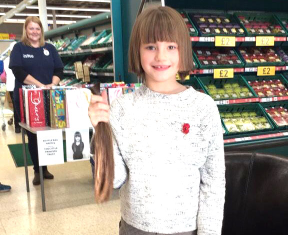 Mya Cuts Off Her Long Hair for Charity