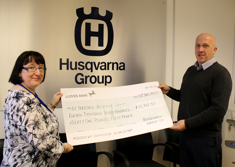Husqvarna Cheque for Hospice
