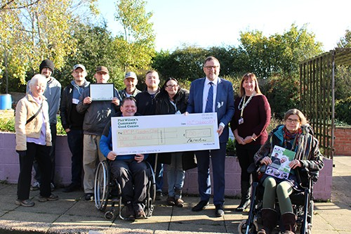 Local MP Dig's Deep to Support Community Garden